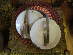 enamel plates and wood handled utensils