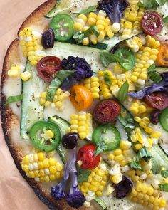 Corn and zucchini pizza on a cauliflower crust with, fontina, tomato, jalapeño, purple cauliflower, a few olives and basil. Have you tried corn on pizza? Delish! Thanks for the recent inspiration @ciaochowlinda ..... ..... #lunch #cauliflowercrust #veggiepizza #pizza #corn #zucchini #veggieoverload #eatyourveggies #summercorn 🌽🌽🌽