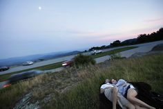 Bud Viniconis and Katie Withrock enjoy a quiet moment as dusk settles at the Thunder Hill Overlook just north of Blowing Rock on the Blue Ridge Parkway. Two-thirds of the land along the 469-mile road is privately owned, making it vulnerable to development. Photo: Shawn Rocco - The News & Observer
