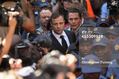 Oscar Pistorius leaves on bail from the North Gauteng High Court on 9/12/14 in Pretoria, South Africa. South African Judge ruled out murder charges yesterday, but convicted him in court today of culpable homicide, as the six month trial of the Olympic double-amputee sprinter comes to an end. His defense maintained that Mr Pistorius mistook Ms Reeva Steenkamp for an intruder in his home when he fired several shots into his bathroom allegedly in self-defence but killing his girlfriend.