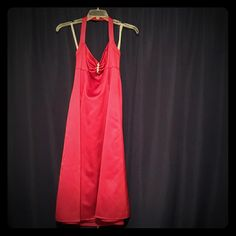Formal Dress Ths gorgeous knee length dress is sure to make you the talk of the party! This beautiful apple red dress can be worn to any occasion that requires a formal dress, and is sure to make you feel completely beautiful. It has only been worn once at a wedding. David's Bridal Dresses Prom