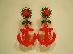 Hey, I found this really awesome Etsy listing at http://www.etsy.com/listing/108073880/red-rose-and-anchor-plugs-0g-8mm-or-00g