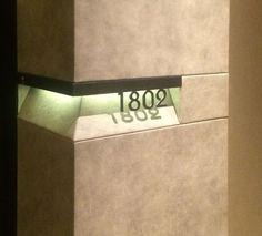 cut metal address signage with illumination from above Hotel Signage, Wayfinding Signage, Signage Design, Environmental Graphic Design, Environmental Graphics, Sign System, Communication Design, Interior Lighting, Architecture