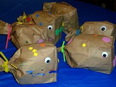Art Activity: Paper Bag Fish     Materials Needed: A paper lunch sack, plain paper bag, crumpled newspaper to stuff the sack, glue, pipe cle...