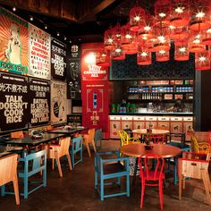 restaurant interior Fook Yew, Jakarta Everything here has been done at the visual equivalent of 100 decibels pretty much every shade in a Dulux sample book crops up somewhere or other but the mainstays are the big boys: red, blue, green and yellow. Deco Restaurant, Restaurant Interior Design, Chinese Restaurant, Cafe Interior, Lantern Restaurant, Colorful Restaurant, Commercial Design, Commercial Interiors, Deco Cafe