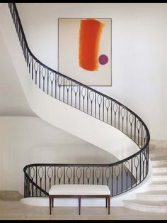 Sleek Parisian style iron railing paired with one vibrant piece of contemporary art