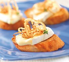 Ile de France® Le Brie Crostini topped with Caramelized Onions