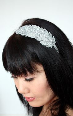 Silver glitter feather headband. £17.00, via Etsy.