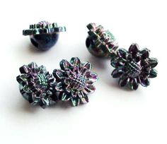 Vintage Irridescent Flower Buttons by heartfelthandiwork on Etsy (Craft Supplies & Tools, Sewing & Needlecraft Supplies, Buttons & Fasteners, Buttons, flower, button, floral, plastic, irridescent, vintage, set, matching, buttons, black, green, purple, embellishment)