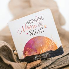 """2016 Moonbeam Medalist. """"This soft yet poignant board book written and illustrated by Rebecca Lefebvre offers the reader, of any age, a gentle, melodic blessing of love and light. Morning, Noon & Night introduces children to the kinship inherent within nature and our vital connection to the world around us."""""""