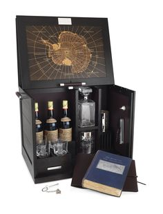 Dunhill's antarctic whisky cabinet, containing bottles of Mackinlay's Rare Old Highland Malt Alfred Dunhill, Drinks Cabinet, Liquor Cabinet, Art Of Manliness, Cigars And Whiskey, Liqueur, Best Gifts For Men, Envelopes, Cool Stuff