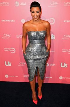 97f0ebfb6e3 Kim Kardashian wore Silver Catherine malandrino dress and hot pink casadei  heels to the Us Weekly party.