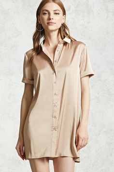 A satin woven shirt dress featuring a basic collar, button-down front, short cuffs sleeves, a vented hem, and shift silhouette.