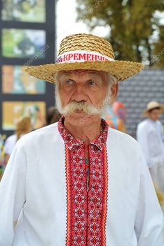 Cossack in a straw hat and wonderful girls in national costumes Stock Image , Man Photo, Editorial Photography, Ukraine, Panama Hat, Cowboy Hats, Stock Photos, Costumes, Portrait, Ua