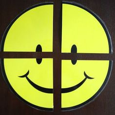 Classroom Management positive reward system: Cut a poster into 4 pieces and put a magnet on the back of each piece.  The class works together to earn pieces of the smiley face for good behavior.  When the class earns all four pieces, they earn a small reward like getting to take their shoes off, chewing gum, or a 2-minute dance party.