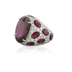 Stunning Asprey Jubilee ring. Ring features over 20ctw of Rubellites and 3.18ctw of diamonds set in 18K white gold. Retails for $29,000.00! DESIGNER: Asprey MATERIAL: 18K Gold GEMSTONE: Diamond, Rubel