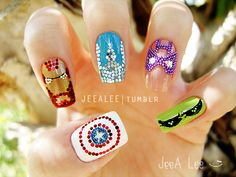 The Avengers nail art by Jeealee (http://jeealee.deviantart.com/art/The-Avengers-Nails-293970428) thumb to pinky: Captain America, Iron Man, Thor, Hawkeye, and the Hulk