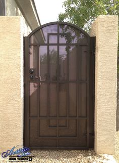 Arched Wrought Iron Gate With Linear Design