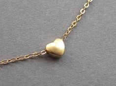 Gold heart necklace, tiny gold heart pendant, gold filled chain, small dainty petite simple modern minimalist on Etsy, $21.00