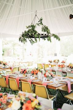 Modern, colorful and unique outdoor tent wedding reception decor - bright yellow chairs, pink napkins + chandelier of bay leaves {GIDEON PHOTOGRAPHY} Tent Reception, Wedding Reception Decorations, Wedding Table, Wedding Ideas, Wedding Receptions, Wedding Bells, Wedding Details, Wedding Stuff, Dream Wedding