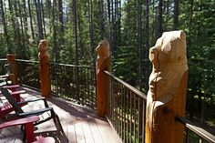 Hand carved log posts on the deck reflect the local wildlife.