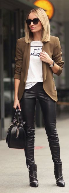 Leather style black pants, bag and boots, nice camel jacket.