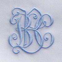 Love the blue monogram on crisp white linen!