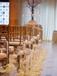 White And Cream Rose Petals Surround Hurricanes That Line The Aisle I Love This For A Inside Ceremony