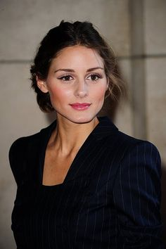 Great make up and hair. No earrings/necklace. Blazer.