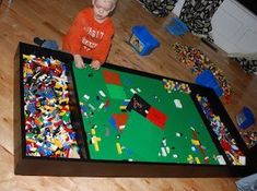 Lego table with storage; on casters to slide under bed