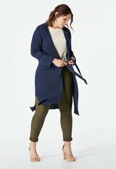 A longline cardigan with an open front and tie belt. Perfect for pairing with dresses or denim....