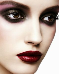 Fabulous smokey eye with purple eye shadow and red lips.