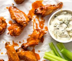 Truly Crispy Oven Baked Buffalo Wings - no false promises here, these wings are seriously crispy and unbelievably easy to make. Tossed in a classic Buffalo Sauce and served with blue cheese sauce. Watch the recipe video to HEAR just how crispy these are! www.recipetineats.com