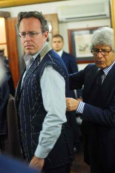 Attending to the coat's balance before the sleeves are set.