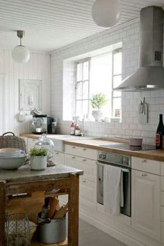 Kitchen--this has the right feel, but don't want shiny subway tile.