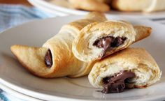 Nutella-Stuffed Crescents I love making these. some times I make 4 regular rolls for dinner and 4 nutella rolls for dessert. Sprinkling with powdered sugar is a must! Nutella Crescent Rolls, Nutella Rolls, Cresent Rolls, Breakfast Recipes, Dessert Recipes, Crescent Recipes, Gula, Nutella Recipes, All You Need Is
