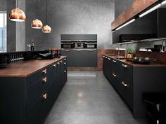 Black is the new white in kitchen cabinets. This color looks great accented with copper tones.