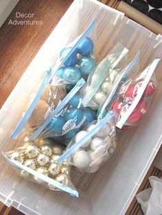 Christmas ornament storage idea: Gallon-size plastic bags let you group ornaments by color or shape. Then when you decorate the tree the following year, you can make sure you hang up decorations evenly by focusing on one bag at a time.