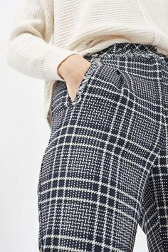 Structured trousers get a modern makeover with this tapered style in cool check print. A cropped hem keeps them casual, while crisp tailored details and frays on the waist give them a chic finish. #Topshop