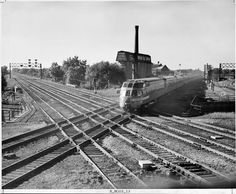 Milwaukee Road's 'Olympian Hiawatha' at Mayfair Tower. The Skytop sleeper-observation car of Milwaukee Road's Olympian Hiawatha bangs across the C&NW diamonds in a 1952 view from the tower at Mayfair, on the north side of Chicago. W. A. Akin Jr. photo