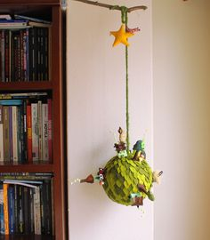 A little world in a big planet. Big ball, cover of small leaves of felt. with one small village, forest, bird, owls and small mushrooms.