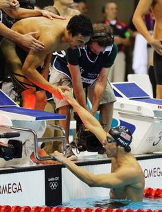 United States' Ricky Berens, left, and United States' Michael Phelps react as they win gold in the men's 4x200-meter freestyle relay swimming final at the Aquatics Centre in the Olympic Park during the 2012 Summer Olympics in London, on July 31.