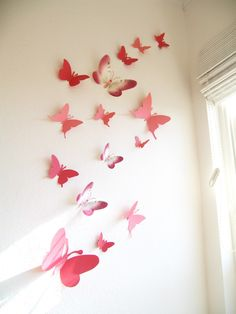 15 Butterflies, Paper, Wall Decor, Hanging, Decal, 3D, Stickers, Coral, Pink, Brown, Gray, Nursery, Baby, Wedding Decor, Baby Shower, Girls Room, Cardstock, Eco-friendly Handmade by Simplychiclily Etsy. $25.00, via Etsy.