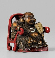 A wood and lacquer netsuke of Hotei as a Zen monk, by Chikusai. Late 19th…
