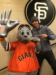 Golden State Warriors' Stephen Curry and San Francisco Giants mascot Lou Seal