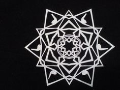 hand-cut paper snowflake with music notes