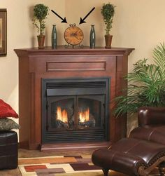 ideas for how to update and accessorize a corner fireplace mantel with decor and artwork. This idea here does not work at all