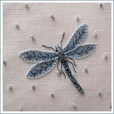 Dragonfly.  The wings look appliqued which wouldn't work for my purposes.  Must figure out another way to do the wings.  Body great.