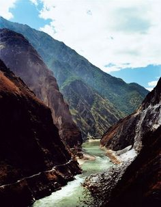Visitors can explore Tiger Leaping Gorge. north of Lijiang, in three ways—raft down the Yangtze River; hike the high road on the east bak (off-camera); or drive to scenic viewpoints along the paved low road, visible here