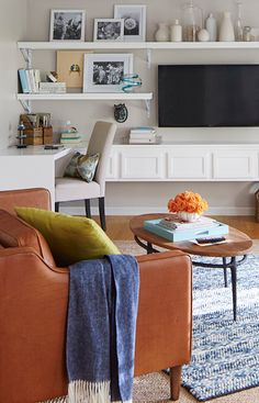 Use stock cabinets as the base for this chic DIY media wall and desk. -- Lowe's Creative Ideas